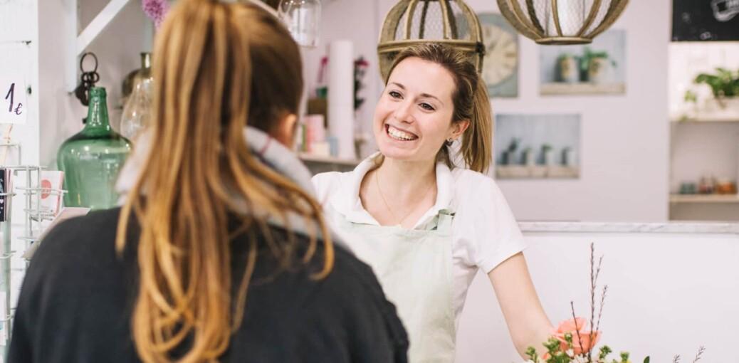 good customer service in retail header image florist smiling